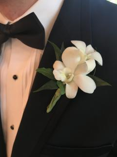 Classic Orchid Boutonniere